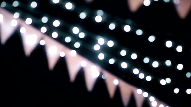 MS Dolly shot of Beautiful Wedding bunting with lights Bokeh by film grain style.