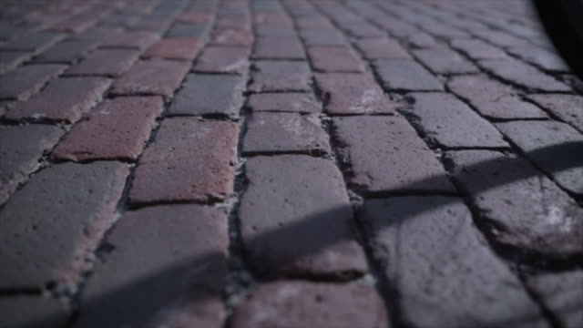 dolly shot of bicycle moving on cobbled street - cobblestone stock videos & royalty-free footage