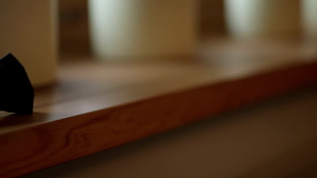 Dolly Shot Of Bowtie On Wooden Table