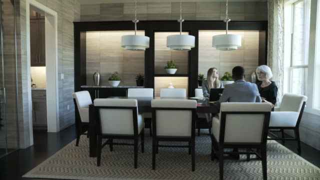 dolly shot of business people discussing in meeting at board room - pendant light stock videos & royalty-free footage