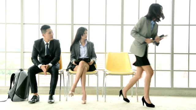 Dolly shot of businesswoman called for job interview in corporate office