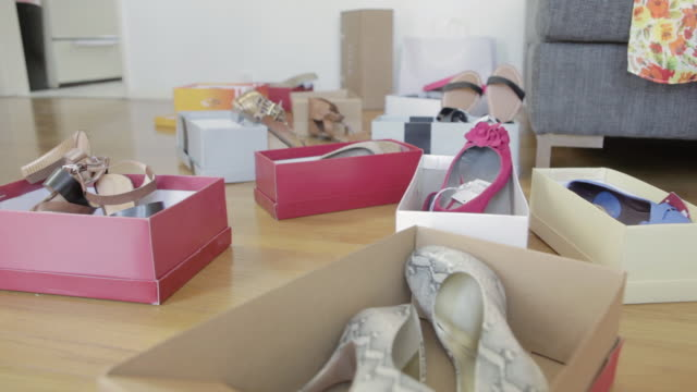dolly shot of caucasian woman trying on red shoes - high heels stock videos & royalty-free footage