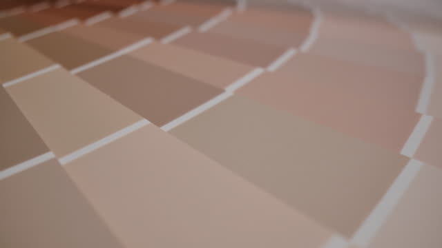 dolly shot of color palette guide for living room - home improvement concept of choosing a color to paint the room - campione di colore video stock e b–roll