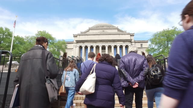 dolly shot of columbia university 2017 graduation event - ivy league university stock videos and b-roll footage