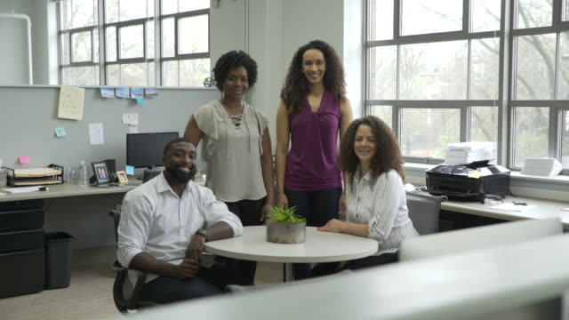 dolly shot of confident business people at table in office - small group of people stock videos & royalty-free footage