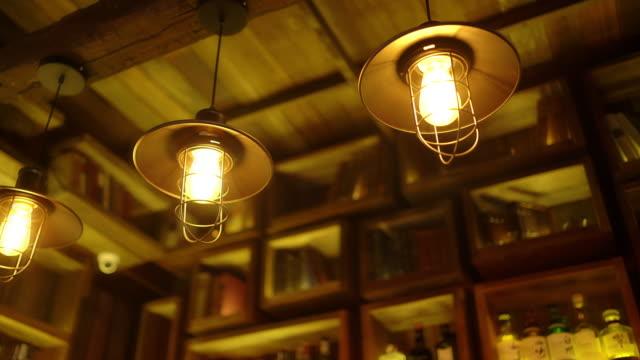 stockvideo's en b-roll-footage met dolly schot van decoratieve verlichting bij staaf - led lampje