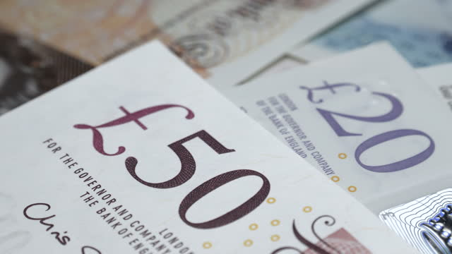 dolly shot of different uk bank notes - finance stock videos & royalty-free footage