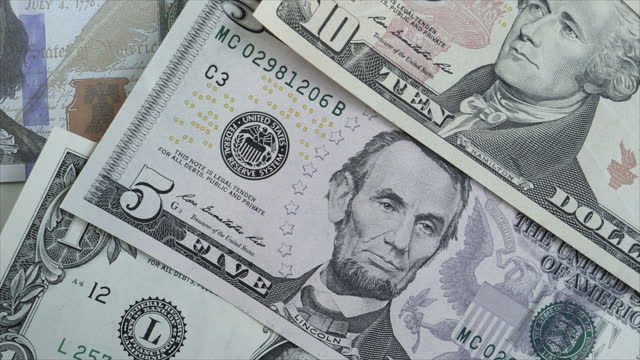 dolly shot of different us dollar notes - abundance stock videos & royalty-free footage
