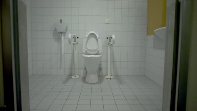 dolly shot of empty public handicap bathroom - smooth stock videos & royalty-free footage