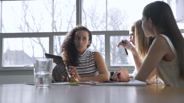 dolly shot of female coworkers planning in meeting at board room - white collar worker stock videos & royalty-free footage