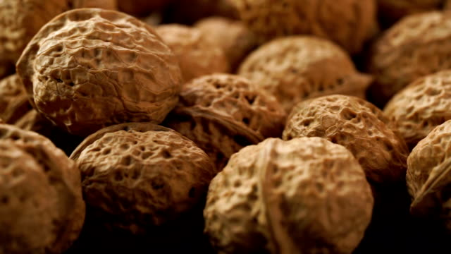 dolly shot of fresh walnuts on table - walnut stock videos & royalty-free footage