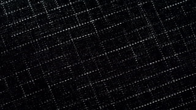dolly shot of Grid pattern fabric background
