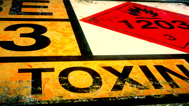 dolly shot of hazardous waste container with warning label for toxins - hazardous area sign stock videos & royalty-free footage