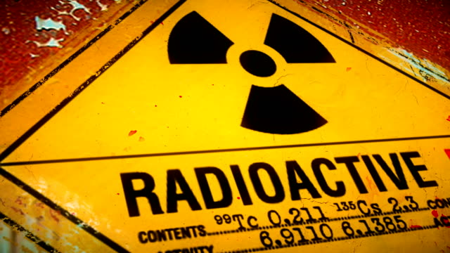dolly shot of hazardous waste container with warning label for radioactive elements - toxic waste stock videos & royalty-free footage