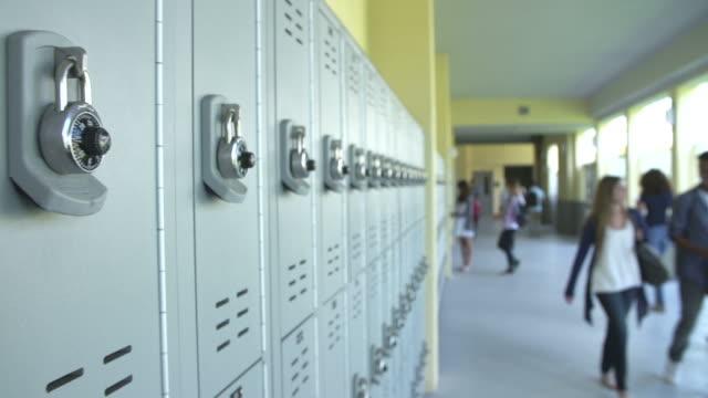 Dolly Shot Of High School Students Walking In Hallway