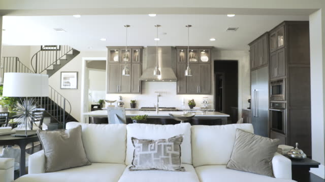 dolly shot of living room and kitchen - pendant light stock videos & royalty-free footage