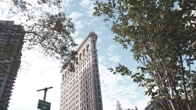 Dolly shot of New York City's Flatiron Building on a warm afternoon.