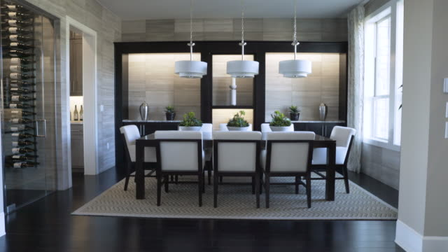 dolly shot of pendant lights hanging over dining table at home - pendant light stock videos & royalty-free footage