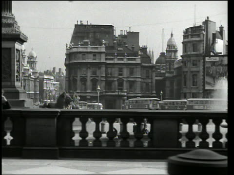 b/w dolly shot of people, buildings + streets of london - 1920 stock videos & royalty-free footage