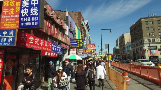 dolly shot of people walking on flushing shopping street, in queens, new york - chinatown stock videos & royalty-free footage