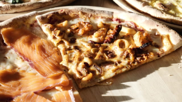 Dolly Shot of Pizza on wooden board