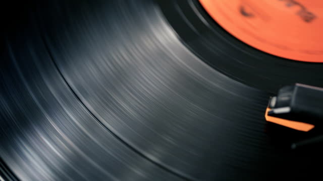 dolly shot of record player playing a spinning vinyl lp - scratched stock videos & royalty-free footage