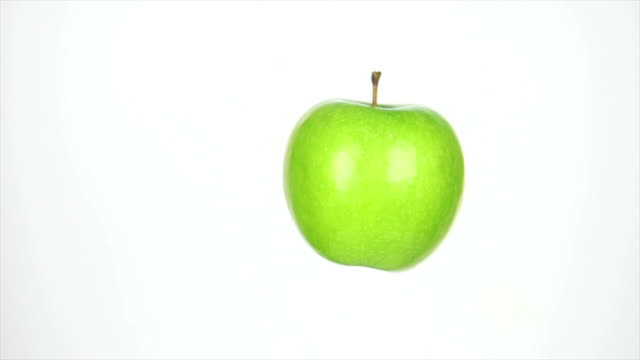 dolly shot of rotating apple isolated on white - weißer hintergrund stock videos & royalty-free footage
