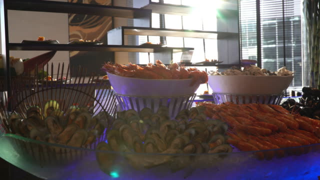 dolly shot of seafood on ice in buffet line - seafood stock videos & royalty-free footage