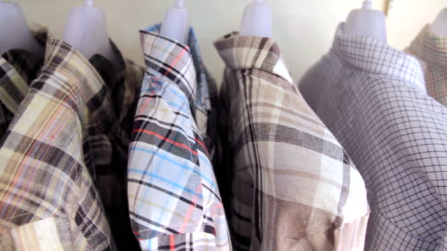 Dolly Shot of Shirts on a coat rack,Close up