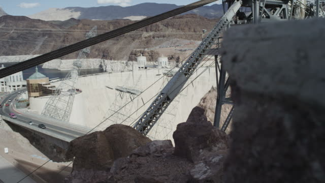 dolly shot of sunny hoover dam - hoover dam stock videos and b-roll footage