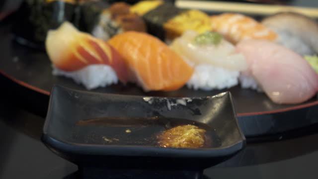 dolly shot of sushi - mollusco video stock e b–roll