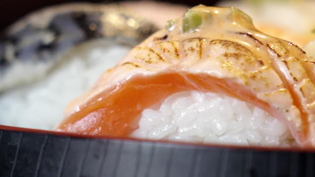 vídeos y material grabado en eventos de stock de foto de carro de sushi - sin editar
