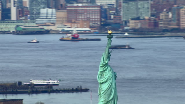 dolly shot of the statue of liberty, in new york city, new york. - female likeness stock videos & royalty-free footage