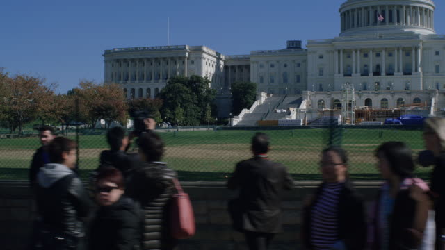dolly shot of tourists taking photographs of capitol building, washington dc., usa - senate stock videos and b-roll footage