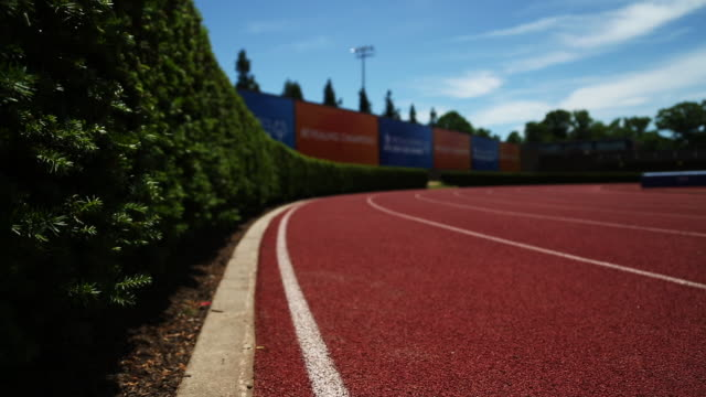 dolly shot of track, track and field. - running track stock videos & royalty-free footage
