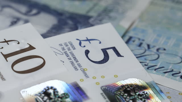 dolly shot of various uk bank notes - spreading stock videos & royalty-free footage