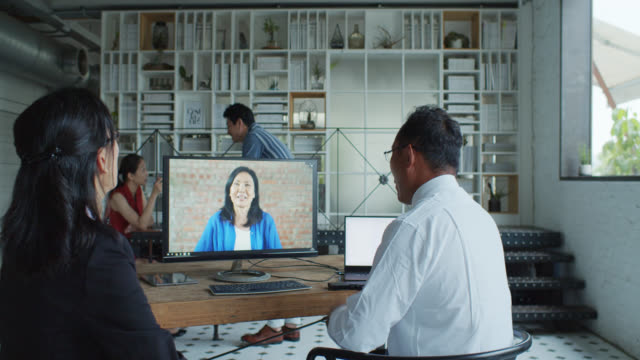 Dolly Shot of Video Conference in Modern Office or Coworking Space