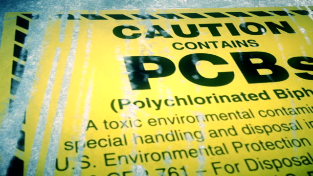 dolly shot of warning for polychlorinated biphenyls pcb hazardous waste - environment stock videos & royalty-free footage