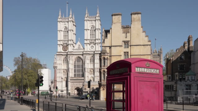 a dolly shot of westminster abbey, with a red telephone box - westminster abbey stock videos & royalty-free footage