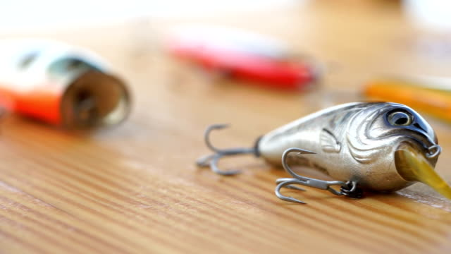 dolly shot on fake bait prepare for fishing - hook stock videos and b-roll footage