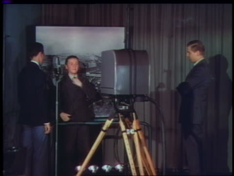 1939 dolly shot out of boy doing television transmission in studio at world's fair - fernsehserie stock-videos und b-roll-filmmaterial