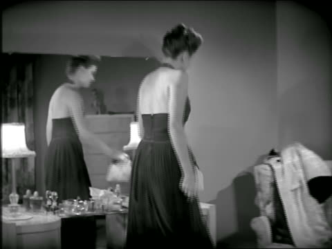 B/W 1946? dolly shot out of woman in formalwear closing purse at mirror / gets up + puts on coat