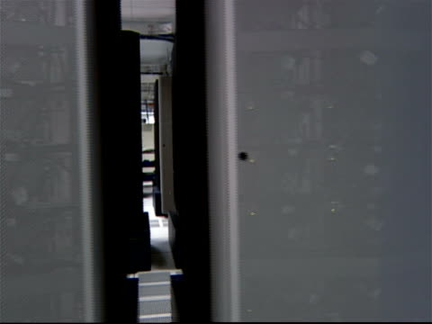 dolly shot past racks of computer equipment in server room / yorktown, new york - 2003 stock videos & royalty-free footage