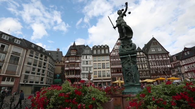 dolly shot: pedestrian crowded at romerberg town square frankfurt germany - rathaus stock videos & royalty-free footage