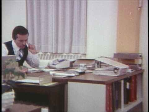 1970 dolly shot people in office talking on telephones - 1970 stock videos & royalty-free footage