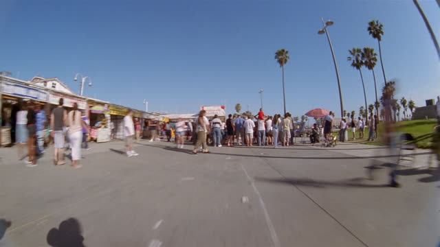 Dolly shot point of view time lapse walking on boardwalk at Venice Beach / Los Angeles