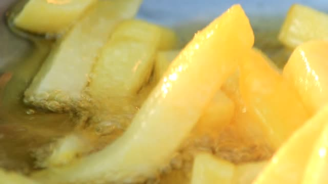 dolly shot potatoes fried in hot oil - crisps stock videos & royalty-free footage