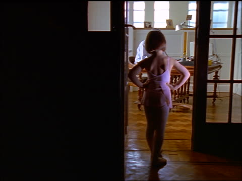 dolly shot rear view little girl in leotard in doorway waiting for father to finish working in home office - oblivious stock videos & royalty-free footage
