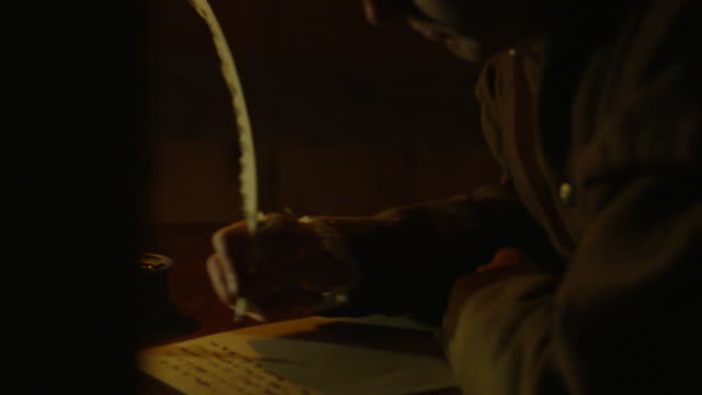 dolly shot reenactment of a man writing with quill pen in colonial america - 17th century stock videos & royalty-free footage
