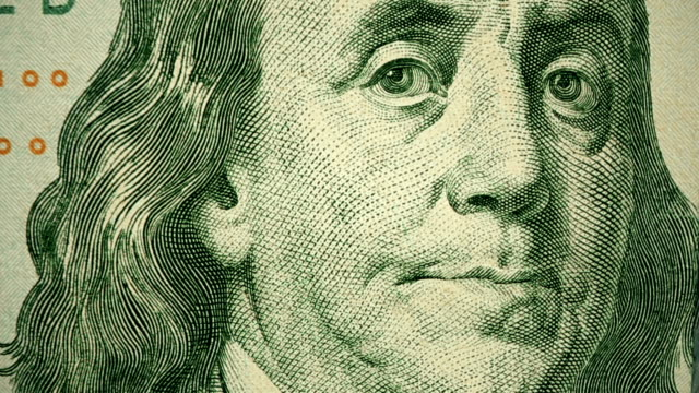 dolly shot showing extreme detail of benjamin franklin's engraving on the $100 dollar bill - dollar symbol stock videos & royalty-free footage